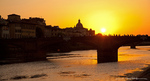 Sunset view over the Arno river from Ponte Vecchio in Florence, Italy